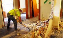 A worker begins demolition on the Minnesota Capitol's 2nd floor.