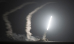 The guided-missile cruiser USS Philippine Sea launches a Tomahawk cruise missile to conduct strikes against ISIL targets earlier this week.