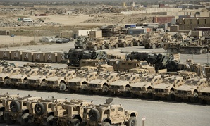 Military vehicles and accessory equipment sit in a retrograde yard at Bagram Airfield, Afghanistan before being shipped out of the country