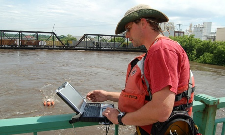 A U.S. Geological Survey employee monitors the Iowa River in Cedar Rapids during the 2008 flood.