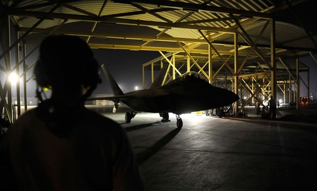 An F-22A Raptor taxis in the U.S. Central Command area of responsibility prior to strike operations in Syria Tuesday.