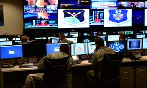 Airmen with the 24th Air Force at Port San Antonio look into their screens during an open house at the facility.