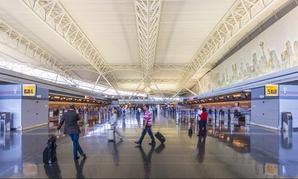 Air travelers walk through New York's John F. Kennedy International Airport in 2013.