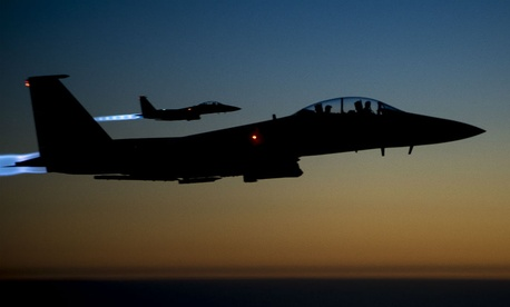 Air Force F-15E Strike Eagles fly over northern Iraq after conducting airstrikes in Syria.