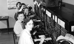 Telephone operators work in Seattle in 1952.