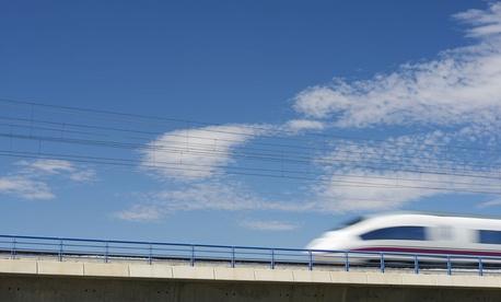 A high-speed train crosses a viaduct in El Burgo de Ebro, Spain.
