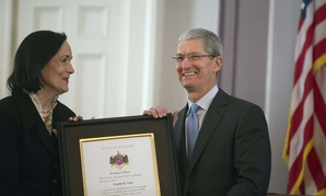 Apple CEO Tim Cook, at right, at the Alabama Academy of Honor induction ceremony at the State Capitol on Monday.