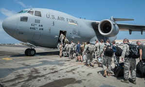A group of 30 U.S. military personnel, including Marines, Airmen and Soldiers from the 101st Airborne Division, board a plane to Monrovia.