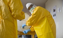 A licensed clinician sanitizes his hands after a simulated Ebola training session on Monday, Oct. 6, 2014, in Anniston, Ala.