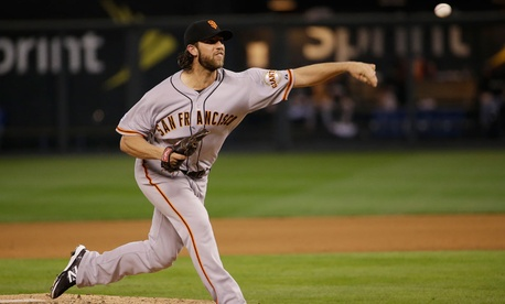 World Series MVP Madison Bumgarner pitches during the clinching World Series seventh game Thursday.