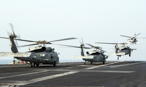 U.S. Navy Seahawks take off from the flight deck of the USS George H.W. Bush in the Persian Gulf, on October 18, 2014.