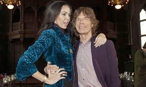 Singer Mick Jagger, right, with his girlfriend, designer L'Wren Scott.