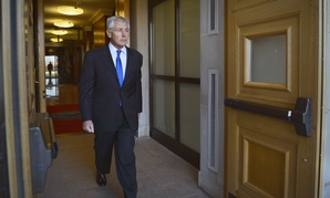 Secretary of Defense Chuck Hagel passes through the River Entrance doors of the Pentagon before a meeting with Qatar's Maj. Gen. Hamad bin Ali Al Attiyah, on November 21, 2014.
