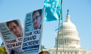 Signs held by protesters during a rally against mass surveillance in Washington, D.C., on October 26, 2013.
