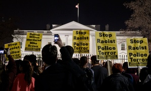 Protestors rally outside the White House Monday night.