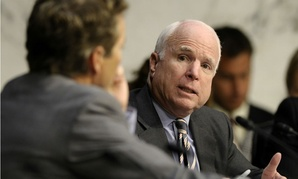 Sens. Rand Paul, R-Ky., and John McCain, R-Ariz., talk during a Foreign Relations Committee hearing.