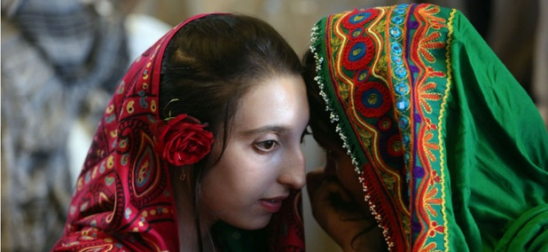 Afghan girls gather to hear a speech by President Ashraf Ghani Ahmadzai, who has pledged to improve representation of women in Afghanistan's government.
