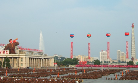 North Koreans participate in a military parade in 2008 in Pyongyang.