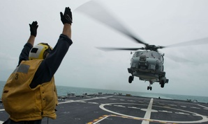 The USS Fort Worth conducts helicopter search and recovery operations as part of Indonesian-led efforts to locate the AirAsia plane that crashed last week.