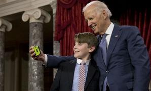 "Joe Biden takes a ""selfie"" with Sen. Jeanne Shaheen's grandson A.J. Bellabona  Tuesday."