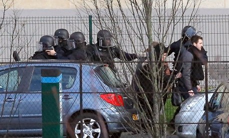 Police officers arrive at the hostage situation at a kosher market in Paris Friday.