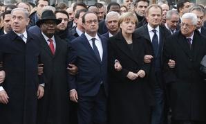 Israel's Prime Minister Benjamin Netanyahu, Mali's President Ibrahim Boubacar Keita, France's President Francois Hollande, Germany's Chancellor Angela Merkel, EU President Donald Tusk, and Palestinian President Mahmoud Abbas march in Paris Sunday.