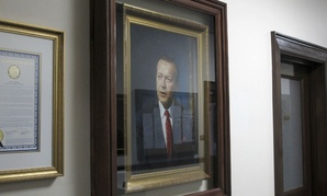 A portrait of the late-U.S. Sen. Ted Stevens hangs in the Alaska state Capitol.