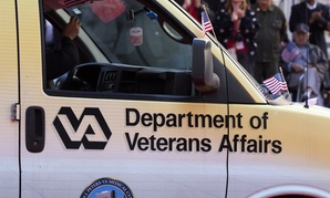 A VA truck rides down the street during a Veterans Day parade in 2014.