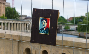A sign supporting Edward Snowden sits on a bridge in Berlin.