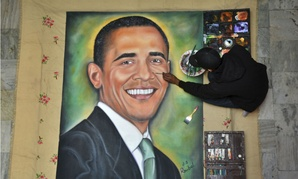 Indian artist Jagjot Singh Rubal finishes a painting of Obama in preparation for the president's visit.