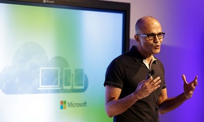 Microsoft CEO Satya Nadella gestures while speaking during a press briefing on the intersection of cloud and mobile computing.
