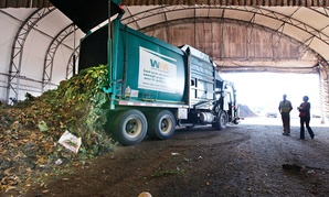 s a truck dumps compost materials inside a receiving area at the Cedar Grove processing facility in Everett, Wash. in 2011.