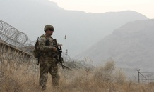 A soldier keeps watch at the Afghanistan-Pakistan border.