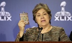 Sarah Saldaña holds up a counterfeit flask during a news conference Thursday in Phoenix.