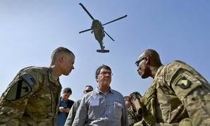 Then-Deputy Secretary of Defense Ashton Carter speaks with service members in Afghanistan, May 2013.