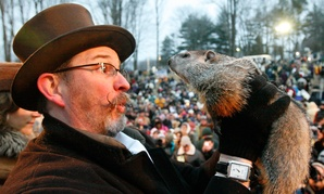 Punxsutawney Phil, held by Ben Hughes in 2010, is famous for predicting more of the same.