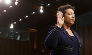 Loretta Lynch closes her eyes as she finishes being sworn in to testify before the Senate Judiciary Committee in January.