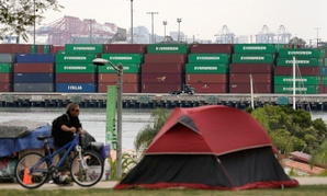 A tent pitched by a homeless person sits on the hilltop overlooking the Port of Los Angeles in February.