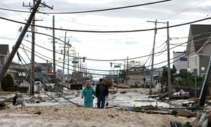 Residents walk in Seaside Heights, N.J., days after Hurricane Sandy made landfall Oct. 29, 2012.
