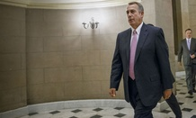 House Speaker John Boehner arrives for Tuesday's vote on the funding bill.