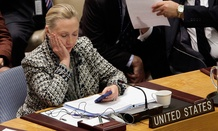 Hillary Clinton checks her phone during a United Nations session in 2012.