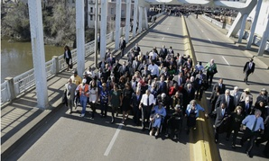 """President Obama, former president George W. Bush and civil rights leaders walk across the Edmund Pettus Bridge in Selma, Ala., to mark the 50th anniversary of """"Bloody Sunday."""""""