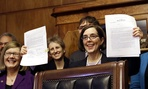 Oregon's new governor, Kate Brown, signed the automatic registration law on Monday.