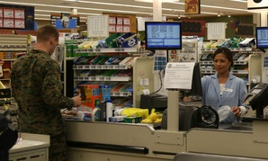 A customer checks out at the commissary at Marine Corps Air Station New River, N.C.