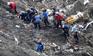 Rescue workers work on debris of the Germanwings jet at the crash site near Seyne-les-Alpes, France, Thursday, March 26, 2015.