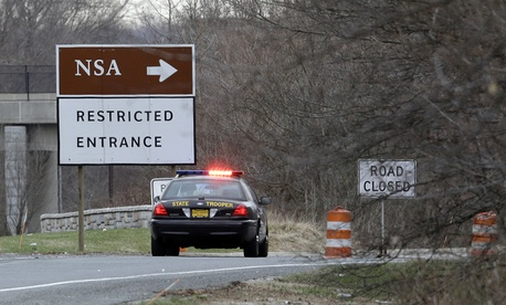 A Maryland State Police cruiser blocks an entrance to NSA Monday.