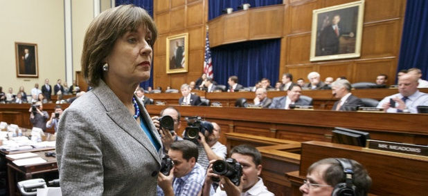 Lois Lerner leaves a congressional hearing after declining to testify.