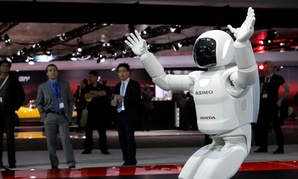 The Asimo Robot made by Honda is displayed at the New York International Auto Show.