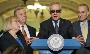 Senate Minority Leader Harry Reid speaks to reporters following a policy luncheon last week, flanked by (from left) Sens. Patty Murray,  Dick Durbin and Chuck Schumer.
