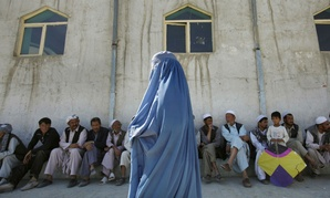 An Afghan woman walks to a polling station in Kabul.